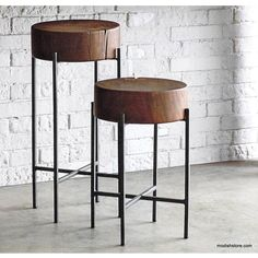 A pair of side tables in walnut-stained acacia has great styling that fits into a myriad of settings. Thick slices of naturally aged acacia are each inset with
