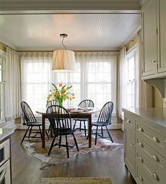 Anne Decker Architects | Selected Works | Renovations | New Orleans Influence Kitchen dining area.. Simple sheer panels complete the space.