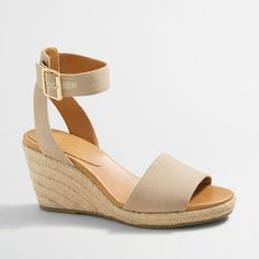 Canvas upper. Man-made sole with cork insert. Wedge covered in natural jute. 3 3/8 heel. Online exclusive. Import.