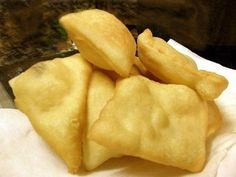 New Mexico Sopapillas ~ served in all of the restaurants...it is dough thinly rolled out & dropped into hot grease. They puff up with & have air on the inside - can open them up & put honey in them or you can stuff them with meat, beans, & cheese...serve with guacamole, lettuce & tomato. They are DELICIOUS!!