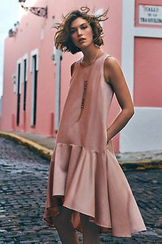 """Soft pink ruffled dropwaist high-low hem daytime cocktail dress with side pockets and pullover styling by Anthropologie """"Camellia"""""""