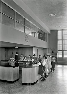 "Feb. 1, 1941. ""Brooklyn Public Library (Ingersoll Memorial), Prospect Park Plaza. Librarian's desk, sharp view."" 5x7 acetate by Samuel Gottscho."