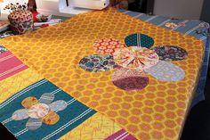 Little Folks Garden Quilt -- yo-yo flowers by maureencracknell, via Flickr