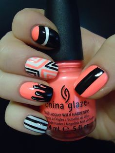 Coral, black, and white nails