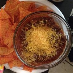 Slow Cooker Venison Chili for the Big Game Recipe Main Dishes with boneless venison steak, pork sausages, onion, garlic, tomato paste, hot pepper sauce, salt and ground black pepper, cannellini beans, diced tomatoes, chili powder, shredded cheddar cheese