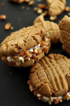 miettes delicious, fat, bakery-sized peanut butter sandwich cookies that are soft and thick in the center and crisp on the outside, filled with fluffy marshmallow meringue and rolled in honey roasted peanuts