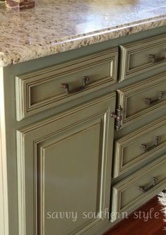 Annie Sloan chalk paint ... no sanding, no priming required. Kitchen Cabinets painted with Chateau Grey Annie Sloan Chalk Paint: $35, Annie Sloan Lacquer: $54, Valspar Translucent Glaze in Mocha: $15