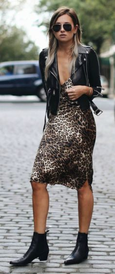 Break the mould this season + animal printed slip dress + Danielle Bernstein + leopard print piece + plunging neckline + leather jacket + perfect blend of sexy sleekness. Dress: Nili Lotan, Jacket: R13, Boots: Archive.