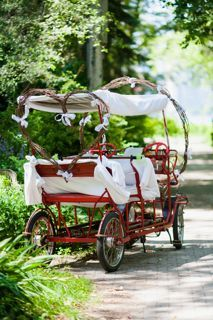 Forget a gas-guzzling limo. Our wedding transportation: a pedal-powered quadricycle! Photo by Artage Pictures.
