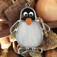 Stained Glass Penguin, Tiny Stained Glass Penquin, Christmas Ornament, Package Tie. $7.50, via Etsy.
