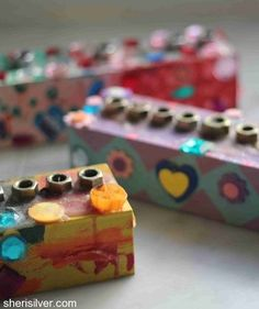 Who knew you could shop for holiday decorations at the hardware store? With wood blocks, stickers, and a few nuts, you can create a unique menorah that every child can personalize.