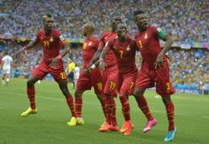 World Cup 2014: Best Celebrations In Pictures - Ghana's forward and captain Asamoah Gyan (R) celebrates with teammates after scoring during a Group G football match between Germany and Ghana at the Castelao Stadium in Fortaleza during the 2014 FIFA World Cup on June 21, 2014.