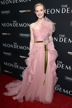 """Elle Fanning wore a Gucci one shoulder tulle gown with plisse ruffles, green velvet belt and silk flowers to the premiere of """"The Neon Demon"""" in New York."""