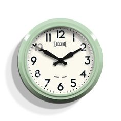The iconic, mid-century inspired Electric wall clock in Kettle Green. This retro railway station clock has withstood the test of time to become a modern classic.
