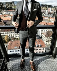 Perfect winter fashion with a suit, sweater and tie.