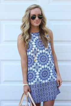 This would be perfect for Greece this summer! I love this because of the neck line, shows off my arms, and would be light for warm weather. Blue and white are my favorite color combos.