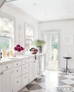 Love this kitchen! I also love that she painted the floor with the black & white diagonal checker board! So cute!