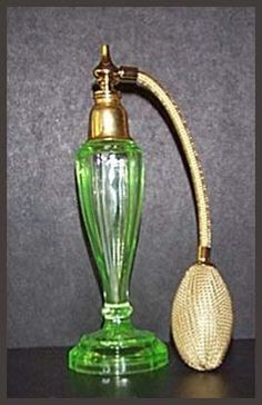 A very pretty vintage perfume atomizer for your vanity.