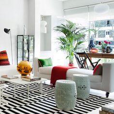 Un salón luminoso con decoración desenfadada de Merry Design Studio
