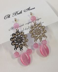 SUZIE Q Spun pink glass beads dangle from laser cut super thin silver tone metal hypoallergenic findings.
