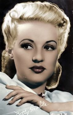 Betty Grable, singer, dancer, actress, pin-up girl of WWII, Girl with the million dollar legs, married to Jackie Coogan and Henry James (How To Marry A Millionaire) 1916-73