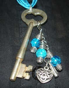 Antique Key Necklace with Heart and Lock Charms and Blue and Silver Beads on Ribbon via Etsy