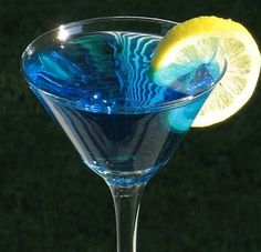 Catwoman Cocktail ~ 1 oz. Citron Vodka 1 oz. Blue Curacao 1 oz. Lemon Schnapps .5 oz Triple Sec 2.5 oz. Sprite (or 7-Up) Citrus fruit wheel for garnish
