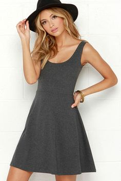 Throw caution to the wind in the Devil May Flare Dark Grey Dress! Soft and light stretch knit forms a fitted sleeveless bodice that shapes your frame in all the right places. Delicately flowing below is a flaring skater skirt to show off your flirty side. Unlined. 100% Polyester. Hand Wash Cold or Dry Clean. Made with Love in the U.S.A.