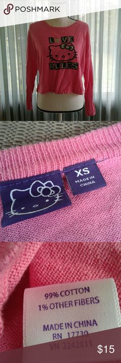 """Hello Kitty sweater Women's like new pink hello kitty lightweight crop sweater with """"love rules"""" and hello kitty face on front. Small side slits. Adorable!! Juniors XSmall. Thanks for looking! Bundle to save! Hello Kitty Tops Sweatshirts & Hoodies"""
