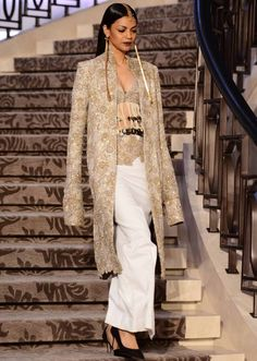 Model walks the ramp in white and gold embellished outfit for Anamika Khanna's Sculpt collection at Lakme Fashion Week Summer Resort 2015