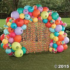 Luau Lantern Archway Idea | Luau like never before with this colorful addition to your DIY party decorations! Makes a great spot for luau photos! #luau #DIY #decorations