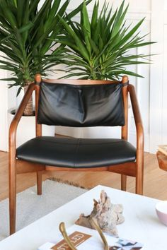 This mid-century gem of a chair is expertly crafted from generously proportioned rubberwood doweling, rounded in all the right places. Photo by City Farmhouse. Find Furniture, Furniture Deals, Leather Lounge, Leather Chairs, Wayfair Living Room Chairs, Perfect Little Black Dress, Patio Chairs, Swing Chairs, Small Sofa
