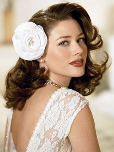 Wedding curly hairstyles for medium length hair with side swept bangs and flower