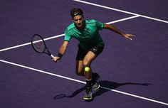 Roger Federer Photos Photos - Roger Federer of Switzerland in action against Juan Martin Del Potro of Argentina at Crandon Park Tennis Center on March 27, 2017 in Key Biscayne, Florida. - 2017 Miami Open - Day 8