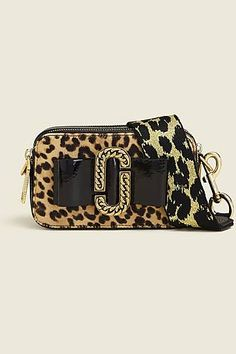 05d705fb9577 Talk a walk on the wild side with this leopard printed small camera bag.  Shop the Marc Jacobs Leopard Bow Snapshot.