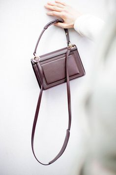 Oxblood leather crossbody bags with gold details for fall