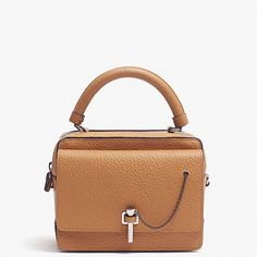 Elegant, structured, spacious-this is our kind of bag. Pin and chain closure, a top handle and detachable shoulder strap make the design easy to carry every day. Materials: 100% leather Made in Morocco