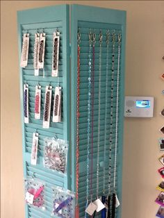 Old bi-fold closet door used to display product in dog grooming salon/boutique