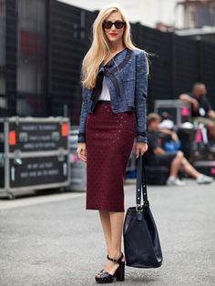 Joanna Hillman, Style Director at Harper's Bazaar, with her Coach handbag. For your chance to win a Coach Legacy Satchel, Coin Purse and Signature Perfume visit: http://www.qvb.com.au/competition/competition/win-a-coach-legacy-satchel-