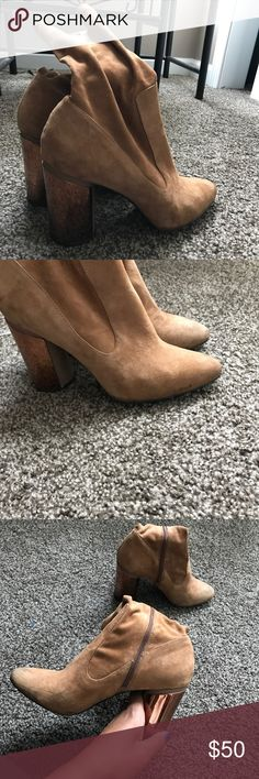 ALDO gold heel suede bootie Worn a total of 4 times in the 3 years I've had them. Some wear to the front of the shoe due to wet/fall weather. There isn't anything wrong with them, they just sit in my closet more than I wear them so I figured I would sell them. Aldo Shoes Ankle Boots & Booties