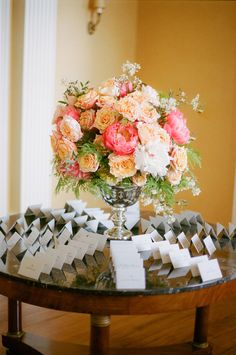 escort card table. look at those flowers <3