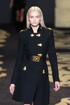 Versace Fall 2011 My favourite Jacket by Versace. Such beautiful tailoring- perfectly fitted to the body, flashy gold button and button hole accents on the double breated front closure.