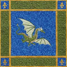 """Dragon on the Wind Applique Quilt Pattern by Needlesongs  Add a touch of legend to your castle with this portrait of a medieval dragon in flight. Make the 36"""" wall hanging shown or follow pattern suggestions for a pointed banner. $10/pattern."""