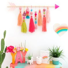24 DIY Tassel Crafts To Make Use Of Leftover Yarn is part of Wall hanging crafts - Discover the best collection of 24 fun DIY Tassel Crafts that are chic and trendy! You won't want to stop making these tassel crafts once you begin Wall Hanging Crafts, Yarn Wall Hanging, Diy Wall Art, Diy Hanging, Wall Hangings, Wall Decor Crafts, Diy Wall Decorations, Hanging Pom Poms, Pom Pom Decorations