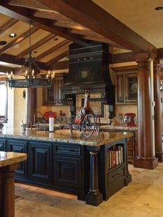Kitchen decor, Kitchen designs, Kitchen decorating ideas - Lovely black island with contrasting cabinetry. The columns give the kitchen a very masculine feel.