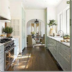 Wood floors, white cabinets, off white countertops. farmhouse kitchen 10