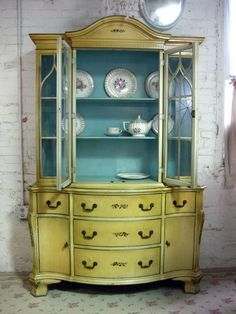 This yellow cabinet with the inside painted baby blue, is sure to bring a lot to the division! ♥ Discover the hottest designs and inspirations on Buffets and Cabinets | Visit us at http://www.buffetsandcabinets.com/ | #buffetsandcabinets #designnews #designinspiration #celebratedesign #interiordesign #designlovers #designbook #furnituredesign #luxuxryfurniture #interiordesigninspiration