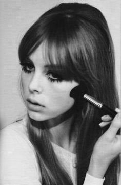 Edie Campbell with Bardot hair and Twiggy lashes.