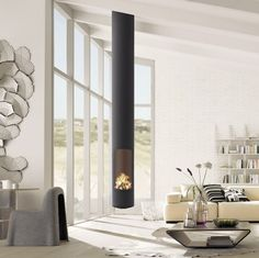 Sleek, modern and minimalist, the Slimfocus suspended fireplace is perfect for smaller spaces and a highly efficient slow-combustion wood heater. Suspended Fireplace, Hanging Fireplace, Wood Fireplace, Fireplace Design, Fireplace Ideas, Mounted Fireplace, Custom Fireplace, Focus Fireplaces, How To Clean Burners