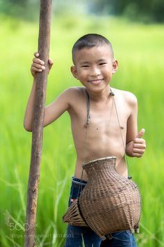 Asian countryside boy smiling happily by Pitakchatr